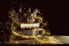 Low key image of beautiful queen/king crown on old books. fantasy medieval period. Selective focus. Low key image of beautiful queen/king crown on old books royalty free stock image
