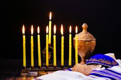 Jewish holiday Hanukkah background with menorah traditional candelabra and burning candles Stock Photography