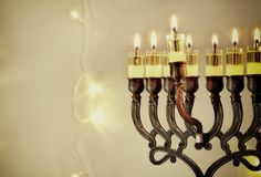 Low key image of jewish holiday Hanukkah background with menorah & x28;traditional candelabra& x29;. Low key image of jewish holiday Hanukkah background Stock Photo