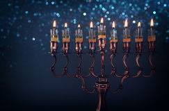 Low key Image of jewish holiday Hanukkah background. With menorah (traditional candelabra) and burning candles stock photos