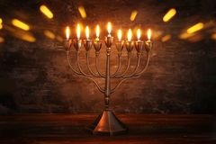 Low key image of jewish holiday Hanukkah background with menorah & x28;traditional candelabra& x29; and burning candles.  royalty free stock photography