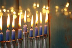 Low key image of jewish holiday Hanukkah background with menorah & x28;traditional candelabra& x29;. And burning candles Stock Image
