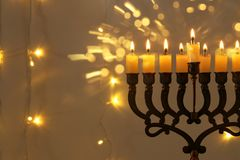 Low key image of jewish holiday Hanukkah background with menorah & x28;traditional candelabra& x29;. Low key image of jewish holiday Hanukkah background Stock Photography