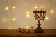 Low key image of jewish holiday Hanukkah background with traditional spinnig top, menorah & x28;traditional candelabra& x29;. Low key image of jewish Royalty Free Stock Images