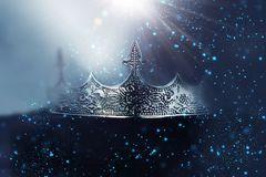 Free Low Key Image Of Beautiful Queen/king Crown Over Wooden Table. Vintage Filtered. Fantasy Medieval Period. Glitter Sparkle Lights Royalty Free Stock Photo - 165709515