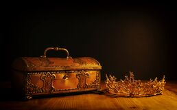 Free Low Key Image Of Beautiful Queen Or King Crown Over Gold Treasure Chest. Vintage Filtered. Fantasy Medieval Period Stock Photos - 215950563