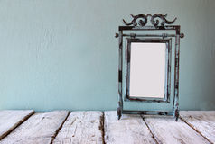 Low key image of old victorian steel blue blank frame Stock Photo