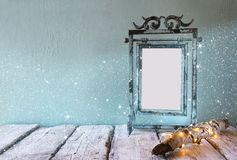 Low key image of old victorian steel blue blank frame Royalty Free Stock Photography