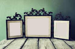 Low key image of old victorian steel blue blank frame . retro filtered image royalty free stock image