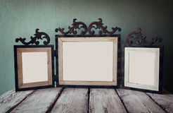 Low key image of old victorian steel blue blank frame . retro filtered image royalty free stock photos