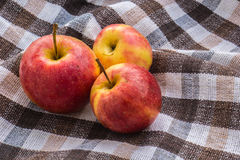 Low key image of red apples over wodden cotton  textured table Stock Photo