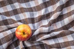 Low key image of red apples over wodden cotton  textured table Stock Photography