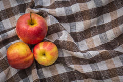 Low key image of red apples over wodden cotton  textured table Royalty Free Stock Photography
