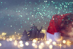 Low key Image of wooden christmas trees and santa hat Stock Photo