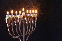 Low key of jewish holiday Hanukkah background. Low key Image of jewish holiday Hanukkah background with menorah (traditional candelabra) and burning candles Royalty Free Stock Photos