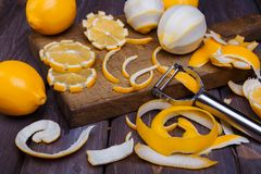 Low key lemons. Some sliced lemons on a wooden cutting board close-up in low key Stock Photos