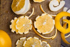 Low key lemons. Some sliced lemons on a wooden cutting board close-up in low key Stock Photography