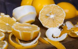 Low key lemons. Some sliced lemons on a wooden cutting board close-up in low key Royalty Free Stock Images