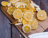 Low key lemons. Some sliced lemons on a wooden cutting board close-up in low key Royalty Free Stock Photo