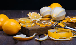 Low key lemons. Some sliced lemons on a wooden cutting board close-up in low key Royalty Free Stock Image