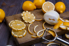 Low key lemons. Some sliced lemons on a wooden cutting board close-up in low key Royalty Free Stock Photography