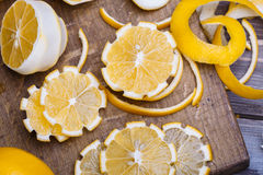 Low key lemons. Some sliced lemons on a wooden cutting board close-up in low key Stock Images