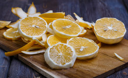 Low key lemons. Some sliced lemons on a wooden cutting board close-up in low key Stock Image