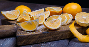 Low key lemons. Some sliced lemons on a wooden cutting board and sea salt Stock Photography