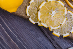 Low key lemons. Some sliced lemons on a wooden table Stock Images