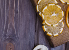Low key lemons. Some sliced lemons on a wooden table Royalty Free Stock Photos