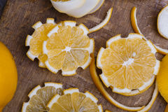 Low key lemons. Some sliced lemons on a wooden table Stock Photography