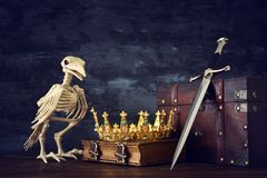 Low key photo of beautiful queen/king crown and sword. fantasy medieval period. Low key photo of beautiful queen/king crown and sword. fantasy medieval period stock images