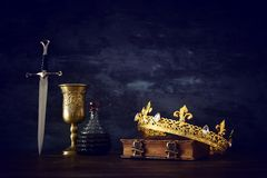 Low key photo of beautiful queen/king crown and sword. fantasy medieval period. Low key photo of beautiful queen/king crown and sword. fantasy medieval period stock image