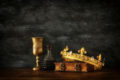 Low key photo of beautiful queen/king crown and sword. fantasy medieval period. Low key photo of beautiful queen/king crown and sword. fantasy medieval period stock photo