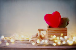 Low key photo of wooden toy truck with hearts in front of chalkboard. valentine's day celebration concept. vintage filtered Stock Image