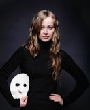 Low key portrait of a beautiful girl with mask Royalty Free Stock Photo