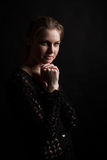 Low key portrait of young woman. Young woman portrait in dark stock photography