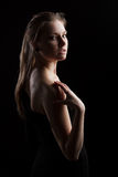 Low key portrait of a young woman. With side lighting royalty free stock photos