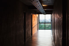 Low key scene of big bright window at the end of walkway Royalty Free Stock Photography