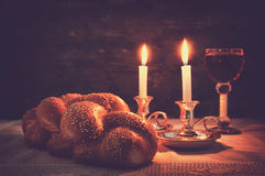Low key shabbat image. challah bread, shabbat wine and candelas Royalty Free Stock Photos