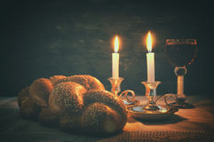 Low key shabbat image. challah bread, shabbat wine and candles stock image