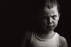 Low Key Shot of a Child with Attitude Stock Photos