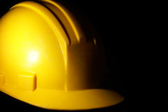 Hardhat. A low key shot of a construction workers hardhat for extra security on the job site Stock Photos