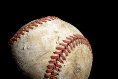 Hardball. A low key shot of an old hardball for a great summer activity Royalty Free Stock Photo