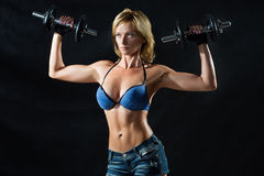 Low key silhouette of a fitness young woman. boobs Stock Image