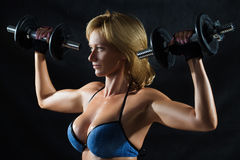 Low key silhouette of a fitness young woman. boobs Stock Images