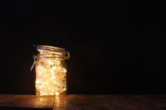 Low key and vintage filtered image of fairy lights in mason jar with. selective focus Stock Image