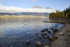 Low-laying clouds near sunrise at Glacier National Park Stock Image