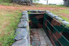 Low level bunker walkway in the ground used in war. stock photos