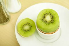 Low level of cholesterol. A kiwi fruit instead of an egg Stock Photography